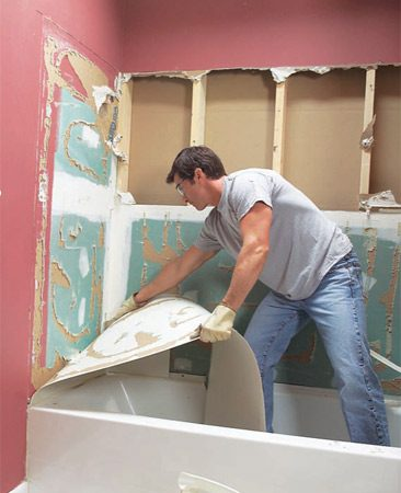 <b>Photo 3d: Remove the final panel </b></br> Remove the cut out drywall after pulling away the last pane. Remove any screws or nails from the exposed studs.