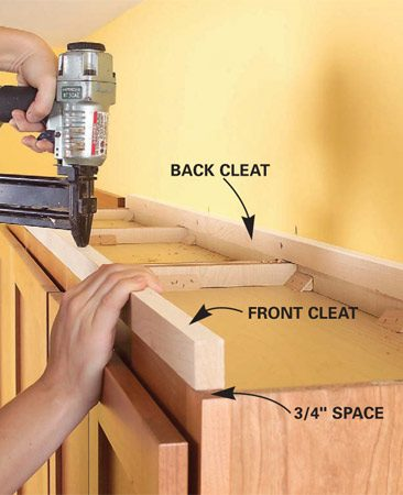 <b>Photo 2: Nail the cleats</b></br> Nail cleats to the tops of the cabinets to elevate the shelf. Leave 3/4 in. of space on each side for the side cleats. The side cleats will overhang on the cabinet side.