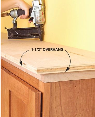 <b>Photo 5: Fasten the top</b></br> Nail the top to the cleats with 2-in. finish nails. Make sure the overhang is even on each side.