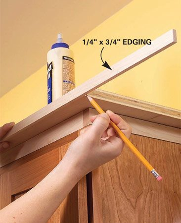 <b>Photo 6: Nail the edge</b></br> Glue and nail the 3/4-in.-wide edge molding to the exposed plywood edges. Miter the corners for a more finished appearance.