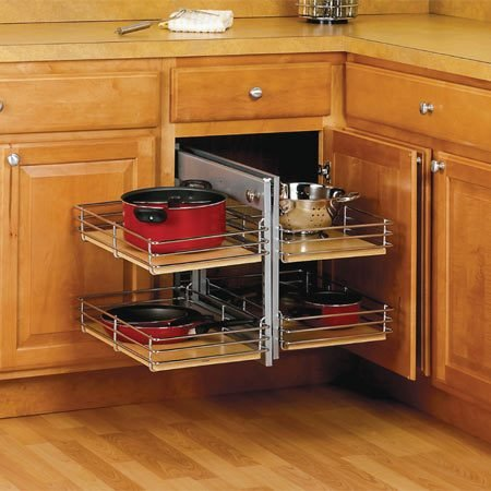 <b>Sliding shelf mechanism</b></br> Various types of fold-out and sliding shelf devices will make corner cabinet space more useable.