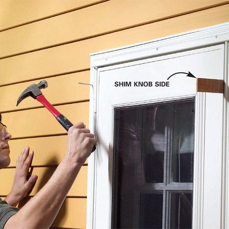<b>Photo 1: Renail the door molding</b></br> Position the door by wedging a shim between the door and the frame. Predrill and drive 10d galvanized finish nails to firmly fasten the molding.