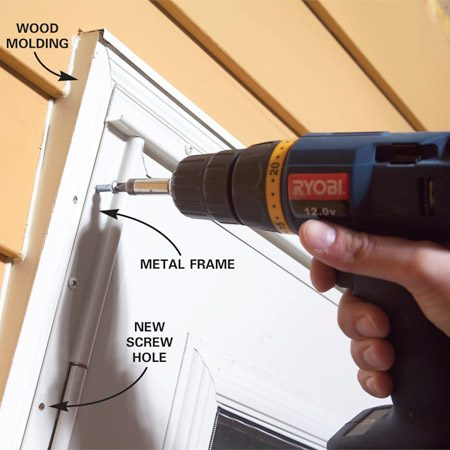 <b>Photo 2: Add additional screws</b></br> Drill new 3/16-in. screw holes through the metal frame. Then drill 3/32-in. pilot holes into the wood and drive in No. 8 x 1-in. screws. For a neater look, spray-paint the screw heads first.