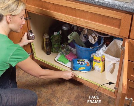<b>Photo 1: Measure your cabinet opening </b></br> Measure the width of your kitchen base cabinet inside the frame. Cut the base (A) 1/4 in. narrower than the opening.