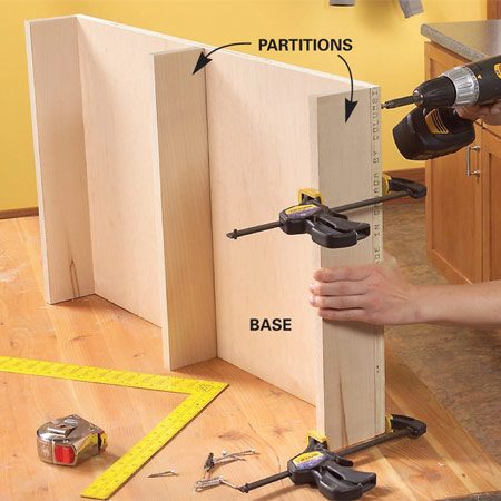 <b>Photo 3: Drill pilot holes before driving screws</b></br> Clamp the partitions to the base, drill pilot holes, and glue and screw them to the base with No. 8 x 2-in. screws.