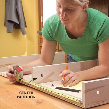 <b>Photo 4:  Measure between the partitions</b></br> Measure the exact distance between the partitions. Make the outer dimension of the tray 1 in. narrower than this measurement to allow for the glides.