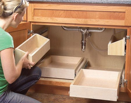 <b>Photo 12: Test the fit</b></br> Slide the upper trays into position and test the fit. Seal the trays with two coats of polyurethane to make cleaning easier.