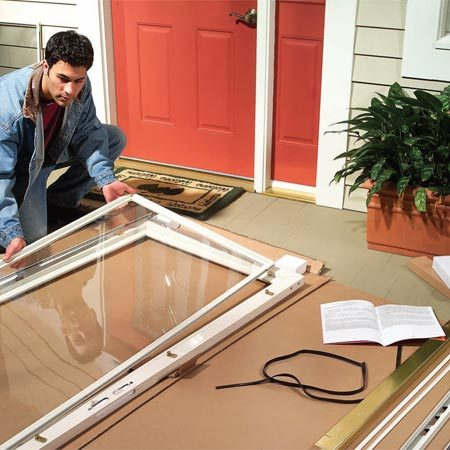 <b>Photo 1: Inspect the door before starting</b></br> Pick a flat area near the entry door, lay the box flat on the ground, fold it open and check to make sure you have all the parts.