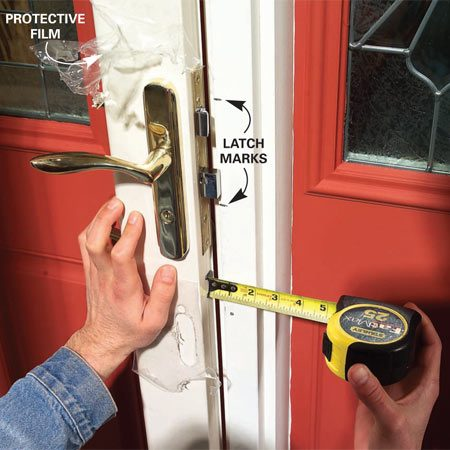 <b>Photo 9: Mount the latch</b></br> Mount the latch mechanism, then mark the position of the top and bottom of the latch on the door casing. If the space between the door and the casing is over 5/8 in., nail two 1/4-in. thick furring strips to the inside of the casing, one above and one below the marks (see Photo 11).