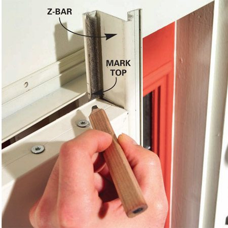 <b>Close-up</b></br> Mark and cut the top of the latch-side Z-bar.