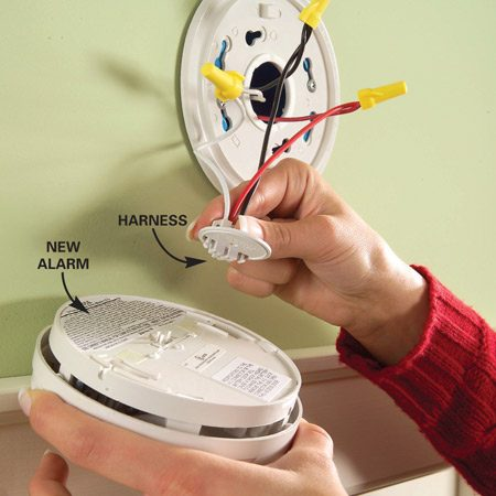 <b>Photo 2: Connect the new alarm</b></br> Screw the new mounting plate to the junction box and connect the wires. Plug the harness into the new alarm, stuff the wires into the box and mount the alarm on the plate.