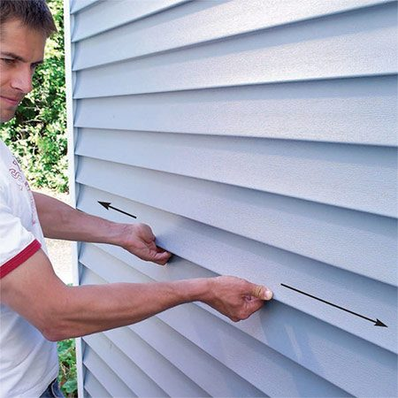 <b>Photo 1: Test each piece</b></br> Each piece of siding should move back and forth at least 1/4-in. if it's been nailed correctly.  Test all the pieces on the noisy wall, and mark pieces that don't move.