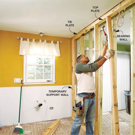 Build a temporary support wall to hold the ceiling up when you install the load bearing beam.