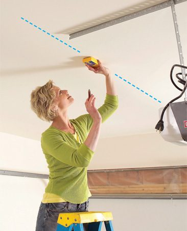 <b>Photo 4: Mark joists</b></br> Locate the ceiling joists with a stud finder and snap chalk lines to mark them. Probe with a finish nail to make sure the lines fall on joist centers.