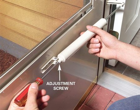 <b>Photo 2: Tweak the adjustment screw</b></br> Turn the adjustment screw to make the door close harder or softer. Make a quarter turn, test the door and continue making quarter turns until the door closes just right.