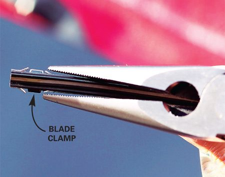 <b>Remove the old blade</b></br> Pinch the retaining clips and slide the old blade out of its frame.