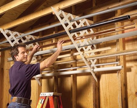<b>Use plastic lattice for long materials</b></br> Plastic lattice works well for storing long lengths of miscellaneous pipe, trim, flashing and conduit. Just cut matching pieces, then screw 2x4 cleats to the ceiling and screw the lattice to the wall studs and cleats. Now you can quickly find those oddball leftovers instead of going to the hardware store and buying yet another piece.