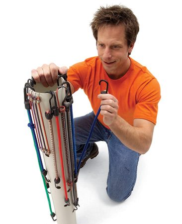 <b>Stretch cords around PVC pipe</b></br> Elastic cords can quickly become a tangled mess. Find the one you need at a glance with this handy rack made from 3- or 4-in. PVC pipe. Just drill 1/2-in.- diameter holes in the pipe to match the slightly stretched lengths of your cords. Keep it in your garage, trunk or shop, out of the reach of children.