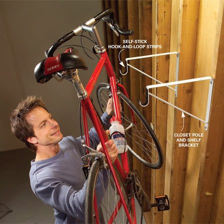 <b>Use closet pole and shelf brackets</b></br> Closet pole and shelf brackets can also keep your bikes up and out of the way of car doors and bumpers. Just screw the brackets to the wall studs. Line the pole carriage with self-stick hook-and-loop strips so it won't scratch your bike frame.