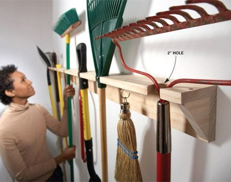 <b>Build a wooden yard tool hanger</b></br> Create a simple long-handled tool hanger out of two 1x4s. On the first one, drill a series of 2-in. holes along the edge of the board. The trick is to center each hole about 1 in. from the edge. That leaves a 1- 1/2-in. slot in the front that you can slip the handles through. Space the holes to accommodate whatever it is you're hanging. Screw that board to another 1x4 for the back and add 45-degree brackets to keep it from sagging.