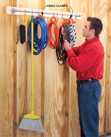 <b>Assemble the parts and hang S-hooks</b></br> Assemble the pipe, elbows, nipples and floor flanges, then screw through the flanges to a horizontal 2x4 set at shoulder height on a garage or shop wall. Attach your S-hooks. If yours don't fit, clamp the hooks in a vise and bend open one end just enough to fit on the pipe after assembly. Now snap Cable Clamps on all your coils and hang them from the S-hooks.