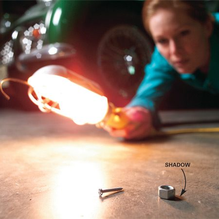 <b>Locate small parts easily with a flashlight </b></br> Here's a slick way to locate small parts that fall to the floor. Turn off the lights and shine a flashlight beam across the floor. When the part is struck by the light, its large shadow makes it easy to find.