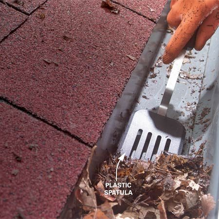 <b>Use a plastic spatula to scoop leaves</b></br> An old plastic spatula makes a great tool for cleaning debris from gutters. It doesn't scratch up the gutter, and you can cut it with snips to fit gutter contours. Grime wipes right off the spatula too, making cleanup a breeze.