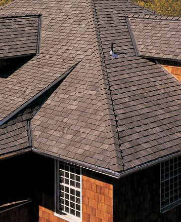 <b>Save money with a metal or shake roof</b><br/>Insurance companies offer big discounts (up to 45 percent) for tough roofing materials.  Talk to your agent to learn about the exact discounts for materials other than standard asphalt. In most cases, metal roofing gives you the largest discount, but it also costs two to four times as much as standard asphalt shingles. For a less expensive roof that still qualifies for a discount, consider heavier grade Class 4 modified asphalt and shake shingles. <br/>Photo courtesy of CertainTeed Corp.