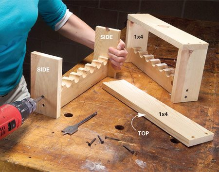 <b>Screw the sides and top to the cradle</b></br> Next, screw 1x4 sides and top to the cradle and screw it to the bottom of your workbench.