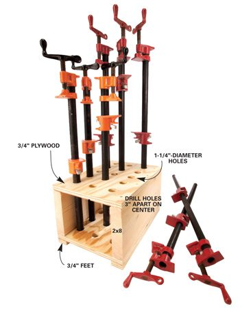 <b>Slide clamps into storage box</b></br> Cut two 12 x 16-in. pieces of 3/4-in. plywood and temporarily screw or nail them face to face. Drill 1-1/4-in. holes (if your pipes are 1 in. outside diameter), spaced 3 in. apart, through both pieces. Pry the plywood apart, then screw them to two 16-in.-long pieces of 2x8 to make an open-ended box. Add a couple of narrow 3/4-in. boards on the bottom for feet, then set the box in a convenient spot along a shop wall. To keep it from sliding, attach it to the studs with screws driven through the 2x8s.