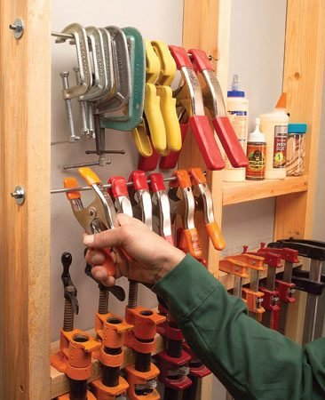 <b>Hang bar clamps between studs</b></br> Clamps scattered and hard to find when you need them most? Here's a way to keep them in one spot. Hang bar clamps on horizontal scraps of 2x4 screwed between open wall studs. Add another board or two for glue bottles, dowels and biscuits
