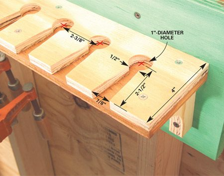 <b>Notch plywood with keyhole-shaped cutouts</b></br> Notch the top piece of 1/2-in. plywood with the keyhole-shaped cutouts as shown, then screw it to the bottom piece of plywood. Make brackets from scrap wood and screw the rack to the wall.