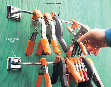 <b>Store clamps on towel rod</b></br> Keep your spring clamps springy for a lifetime! Don't store them clamped on a board; the springs will lose their tension. Instead, keep them on a metal towel rod ($3 at a home center). With the towel rod roost, you'll always know where to find these useful clamps in the heat of production.
