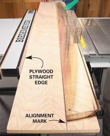 <b>Make the cut</b></br> Push the lumber and the plywood through the saw together.