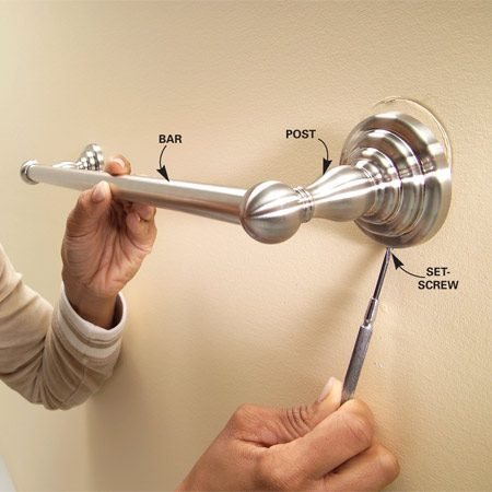 <b>Loosen the setscrew</b></br> Loosen the setscrew that fastens the post to the mounting plate. Remove the post and the bar. Then unscrew the mounting plate from the wall and remove the old anchors.