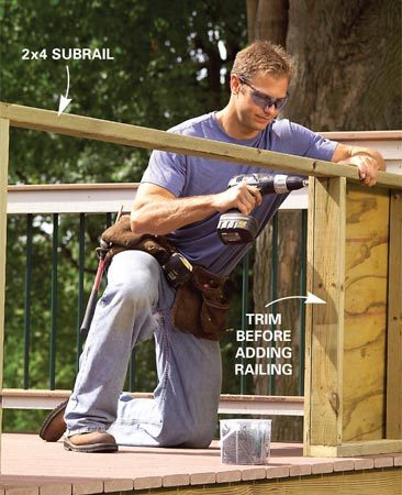 <b>Photo 14: Build the railing end panels</b></br> Frame the solid end panels with the treated 2x4 top subrails and a treated 2x4 fastened to the deck with 3-in. galvanized screws. Add 3/4-in. plywood to cover the sides.