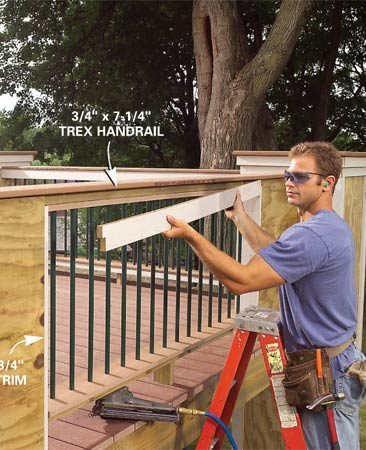 <b>Photo 15: Finish trimming the railing</b></br> Trim the inside faces of the 2x4 frame, then install the lower 2x4 subrail, baluster assembly and trim. Cap the panel with a wider 3/4-in. x 7-1/4-in. Trex board.