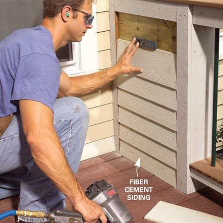 <b>Photo 16: Install fiber cement board</b></br> Cut cement board siding to fit between the trim pieces, leaving a 1/16-in. gap at each end. Use galvanized siding nails and a pneumatic nail gun to secure the siding to the plywood.