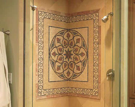 <b>The shower area</b></br> A marble mosaic tile turns this shower stall into a work of art.