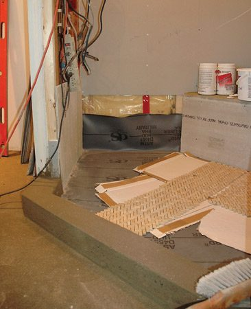<b>Shower enclosure with raw materials</b></br> A long-lasting tile job starts with a solid foundation.