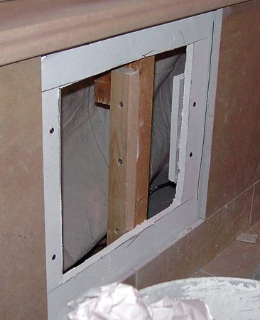 <b>Hidden access doors</b></br> The front panels providing access to the whirlpool tub's motor and plumbing were designed to be the same size, and fall into the same position, as the wall tiles, making the doors nearly invisible.
