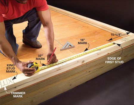 "<b>Then mark studs</b></br> With the openings marked, lay out the stud locations. The goal is to position the studs every 16 or 24 in. so that the edges of 4x8 sheets of plywood align with the centers of studs. Subtract 3/4 in. from the first layout mark. Then hook your tape on a partially driven nail at this mark, and mark at each 16- or 24-in. multiple. Make an ""X"" on the same side of each layout mark to indicate the stud position. Mark studs that land between window or door trimmers with a ""C"" to indicate cripples rather than full-height studs."