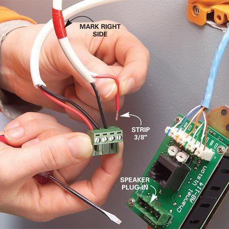 <b>Photo 8: Connect the speaker terminals</b></br> Strip 3/8 in. of insulation from each speaker wire, twist the strands together and push each wire into the speaker hook-ups (red to positive and black to negative). Tighten the screws. Plug the block into the keypad and mount the keypad in the wall box.