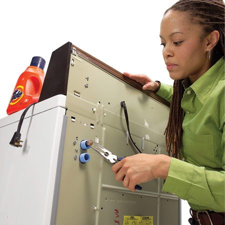 <b>Photo 1: Disconnect hoses</b></br> Turn off the hot and cold water supplies and disconnect the hoses. Use a pair of needle-nose pliers to gently remove the screens for cleaning.