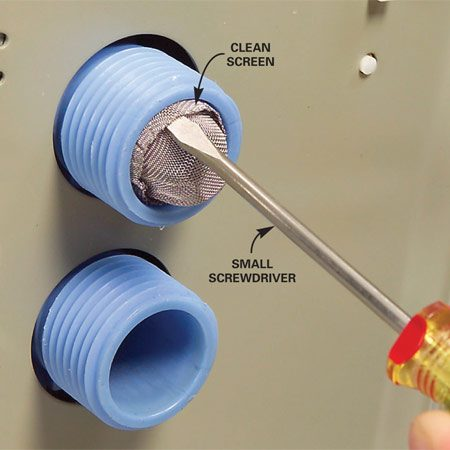 <b>Photo 2: Reinsert the screen</b></br> Work the clean screen back into the inlet by pressing around the rim of the screen with a small screwdriver. Reconnect the hoses, turn on the water and check for leaks.
