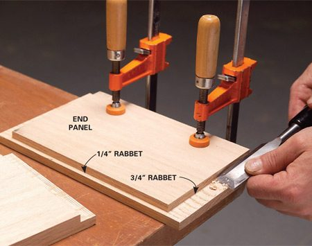 <b>Photo 4: Clean up with a chisel.</b></br> Smooth the saw marks by shaving the rabbets flat with a sharp chisel.