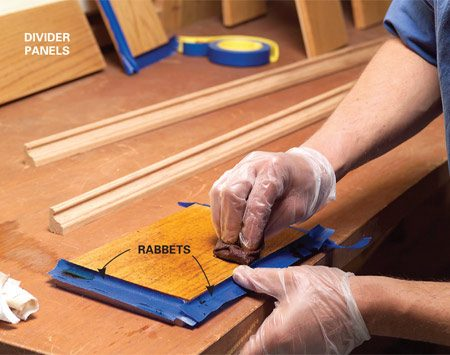 Wear plastic gloves when applying staining. The exposed surfaces of the rabbet cuts have been covered with masking tape to prevent them from being stained.