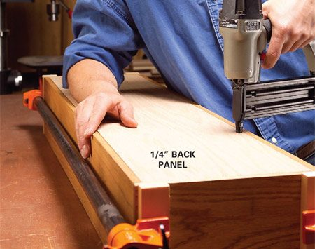 <b>Photo 6: Attach the back.</b></br> Cut the back panel to fit, then glue and nail it into the rabbets with 1-in. brads.