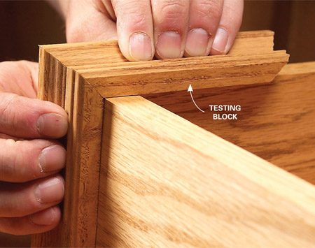 <b>Photo 9: Fit the pieces.</b></br> Use a scrap of cove molding to test-fit lengths. Glue and nail the molding with 1-in. brads.