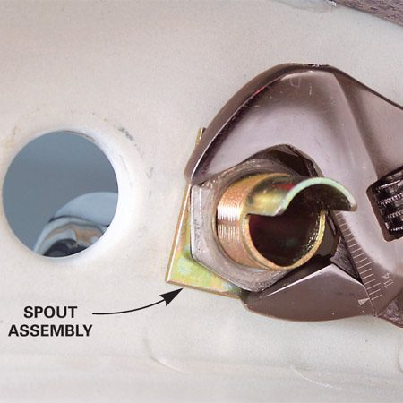 <b>Photo 11:  Improvised solution</b></br> There is usually a solution—in this case partially disassembling the faucet body and then putting the spout assembly in place.